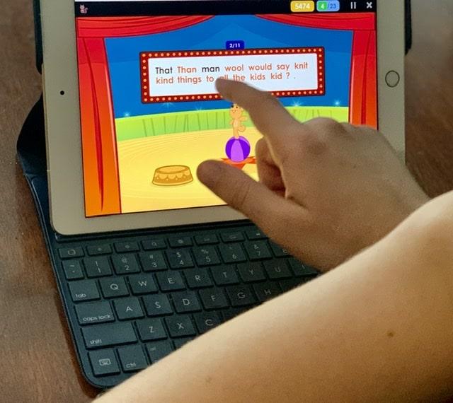 Boy reading iPad screen